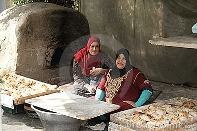 Two female bakers in Cairo Editorial Stock Photo