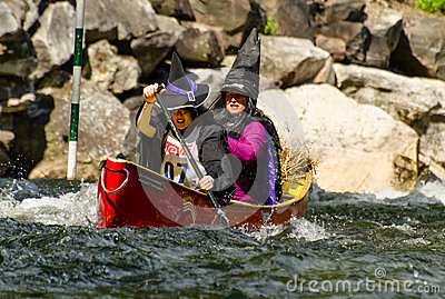 Two female canoeists dressed up in witch costumes Editorial Image