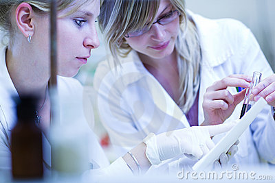 Two female researchers carrying out research