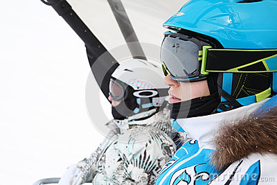 Two female skiers ride on funicular