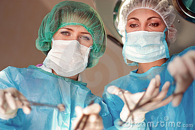 Two female surgeons operate in the hospital