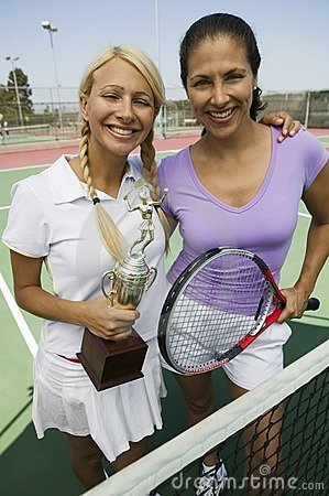 Two female Tennis Players holding trophy
