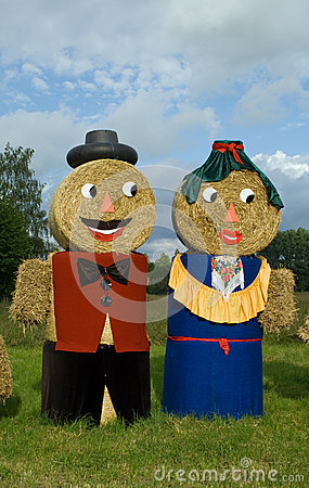 Two figures made out of straw bales