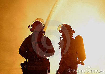 Two firefighters at raging fire