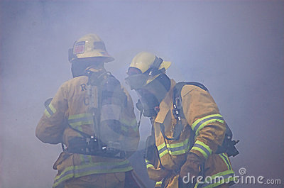 Two Fireman Engulfed in Smoke