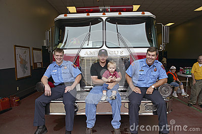 Two firemen, father and son Editorial Photography