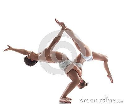 Two flexible acrobats posing in studio