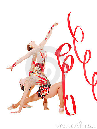 Two flexible gymnasts dancing with red ribbons