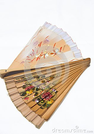 Two folded wooden fans on white