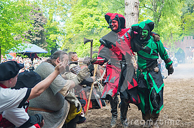 Two fools on the medieval festival Editorial Image