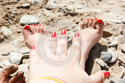 Two foots and one arm on the beach