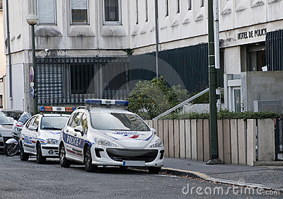 Two french police cars parked in the street