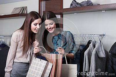 Two friends buy presents in a sale