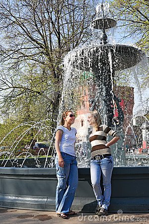 Free Two Friends Chatting Merrily At The City Fountain Royalty Free Stock Images - 20227049