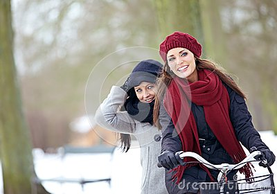 Two Friends Enjoying the Winter Vacation Outdoors