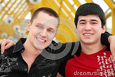 Two friends on footbridge