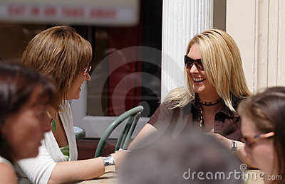 Two friends having a coffee break