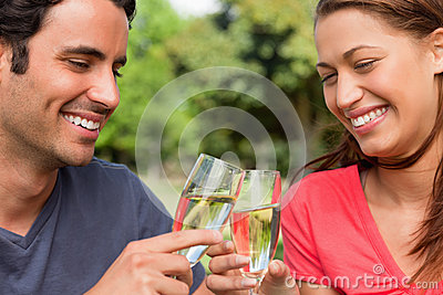 Two friends touching glasses of champagne