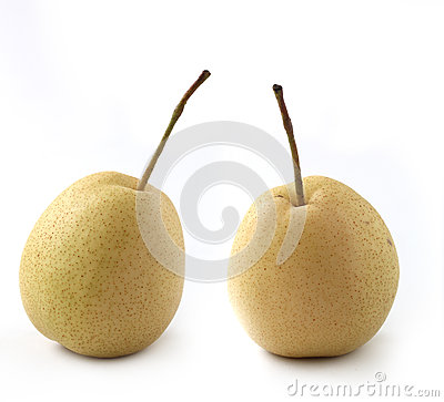 Two fully ripe organic pears on white