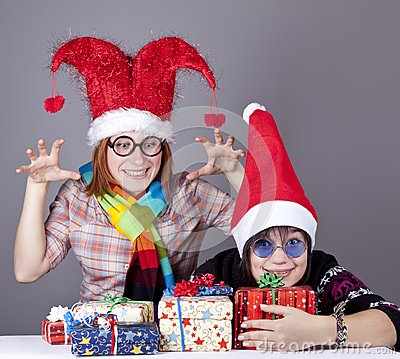 Two funny girls with christmas gifts.