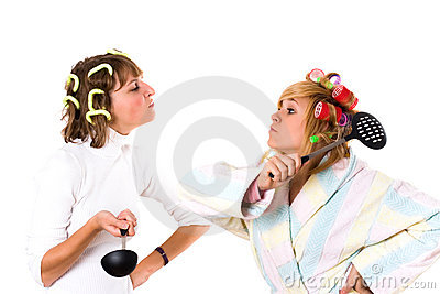 Two funny housewifes with  kitchen utensil