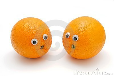 Two funny oranges with eyes on white