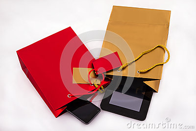 Two gift bags with electronics