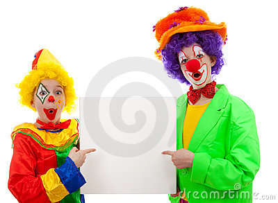 Two girl clowns holding empty text board