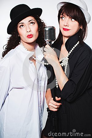 Free Two Girl Singers Royalty Free Stock Photo - 34700085