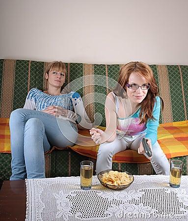 Two girl watching TV