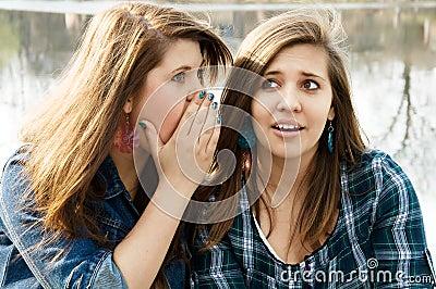 Two girlfriends gossip