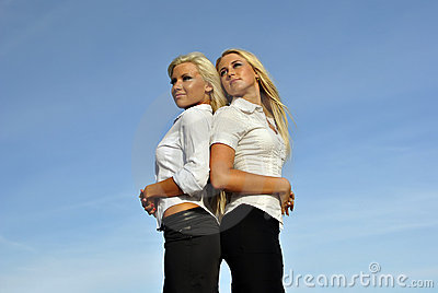 Two girls against the sky. space for text