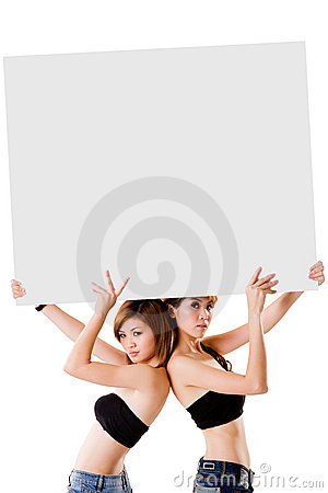 Two girls with a big sign