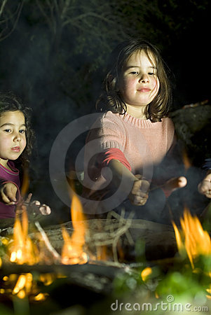 Two girls at a bonfire