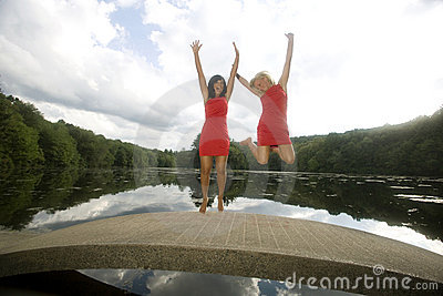 Two Girls on a Bridge Jump for Joy