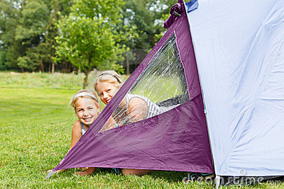 Two girls in camping tent