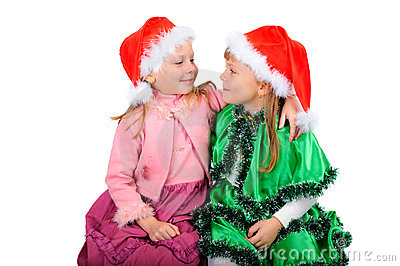 Two girls in caps of Santy.