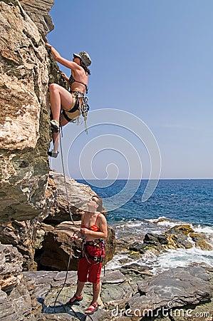 Two girls climbing