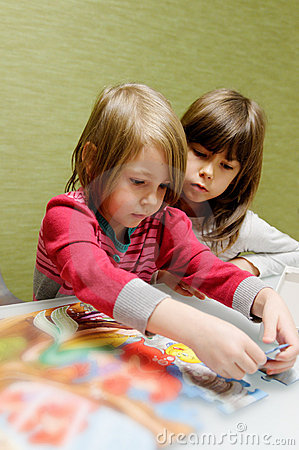 Two girls doing puzzle