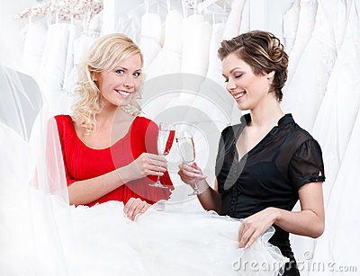Two girls drink champagne or wine