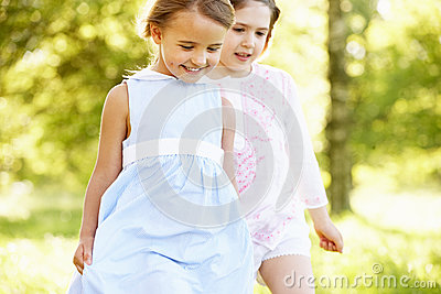 Two Girls In Field Together On A Walk