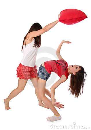 Two girls fighting on the pillows
