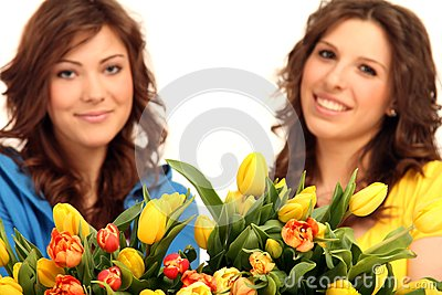 Two girls with flowers
