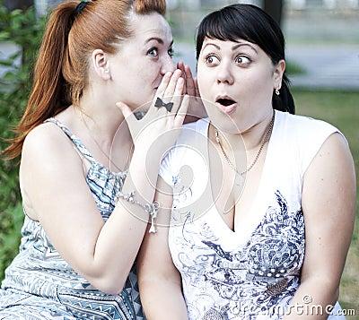 Two girls gossip