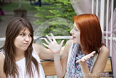 Two Girls Gossiping On Bench At Garden. Stock Photography - Image: 15154992