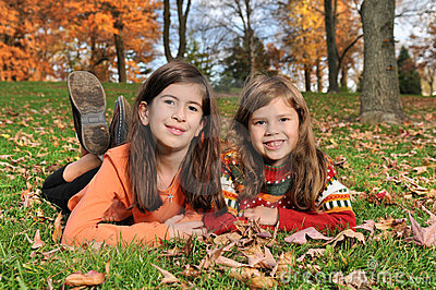 Two Girls On the Grass During Fall