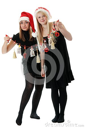 Two girls in hat santa with festoon