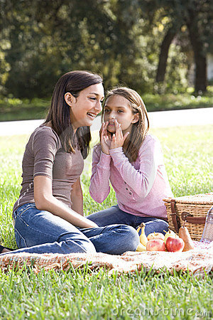 Two girls having picnic in park