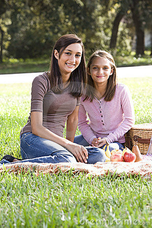 Two girls having picnic in park