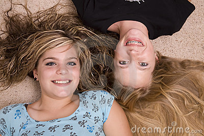 Two girls with heads together